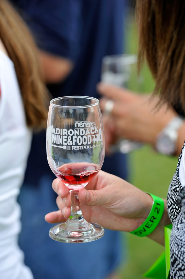 woman-w-a-red-wine-tasting-sample-in-her-glass