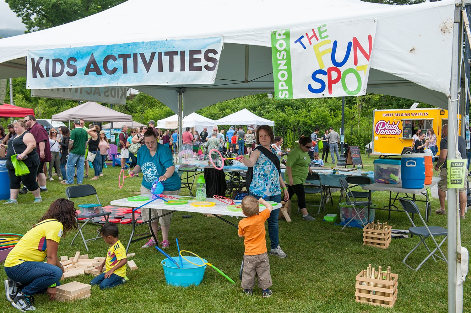 Lake George is a family destination! Aside from a kids activity tent on premise with outdoor games, bubbles & more; there is an amazing natural children′s playground just outside the festival grounds.